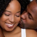 couple kissing cheek